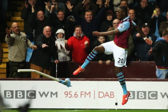 Christian Benteke celebrates his hat-trick in Aston Villa's 6-1 win over Sunderland by kicking a corner flag