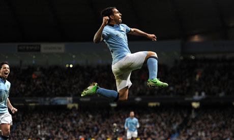 Carlos Tevez celebrates his winner against Wigan Athletic