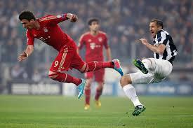 Giorgio Chiellini trips Mario Mandzukic in Bayern Munich's 2-0 win over Juventus