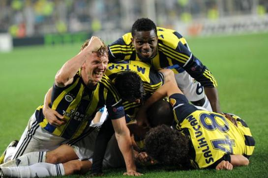 Fenerbahce players celebrate their 1-0 win over Benfica in the Europa League semifinals