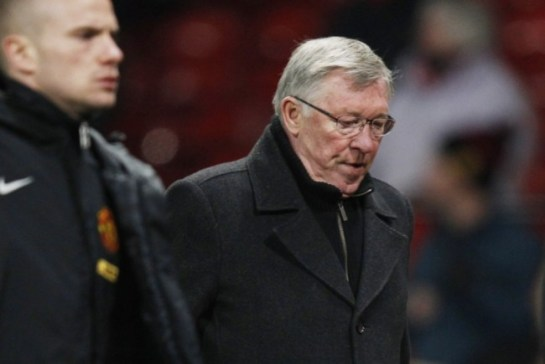 Ferguson looks down with disappointment following the final whistle in United's derby loss