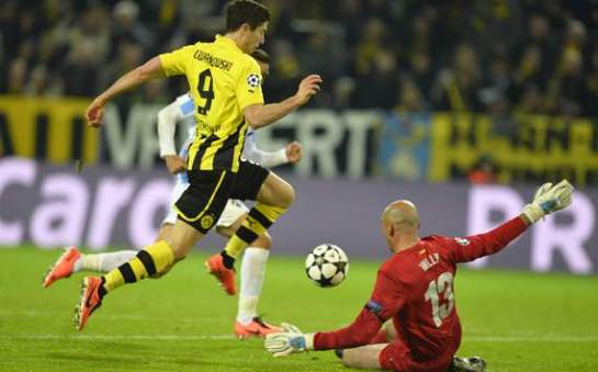 Lewandowski rounds Willy before poking home Dortmund's first goal of the half