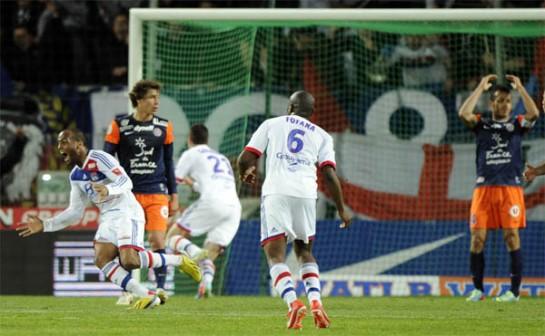 Lyon celebrate their ninety-third minute winner against Montpellier