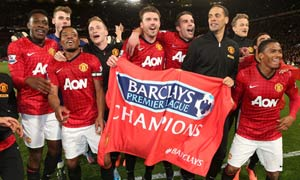 Manchester United celebrate their 3-0 win over Aston Villa, which clinched United's 20th league title