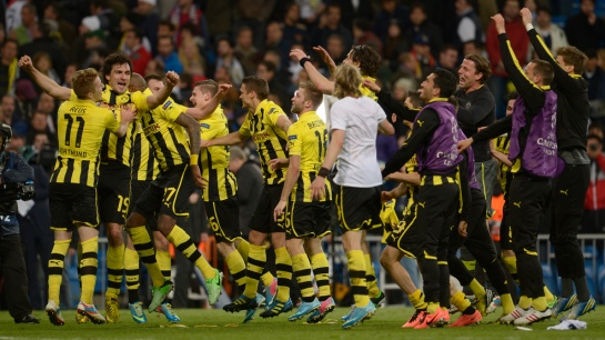 Dortmund players celebrate the win, which seals them a spot in the Champions League finals