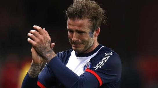 David Beckham cries as he applauds the audience in the last match of his career: a 3- win over Brest.
