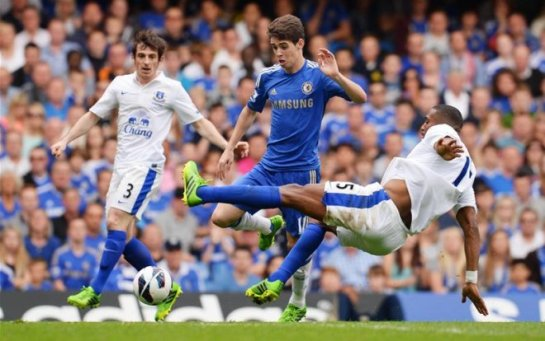 Victor Anichebe challenges Oscar in Chelsea's 2-1 win over Everton