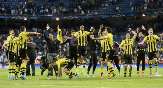 Borussia Dortmund players celebrate their loss to Real Madrid, which sealed them a spot in the Champions League finals