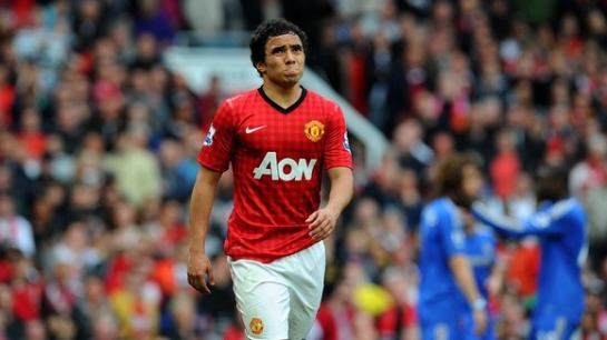 Manchester United defender Rafael frowns after receiving a straight red card for a foul on David Luiz